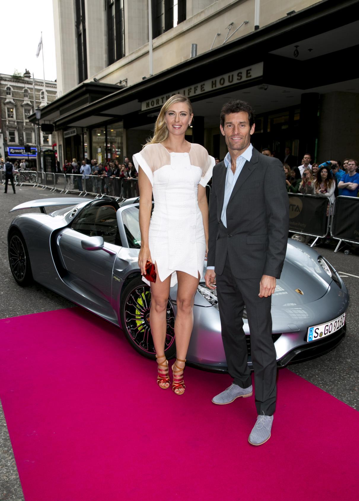 Maria_Sharapova_and_Mark_Webber_arrive_at_the_WTA_at_Kensington_Roof_Gardens_in_the_918_Spyder